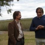 Guillermo Scarlatto conversa con el director de los humedales del Santa Lucía, Ing. Agr. Víctor Denis.